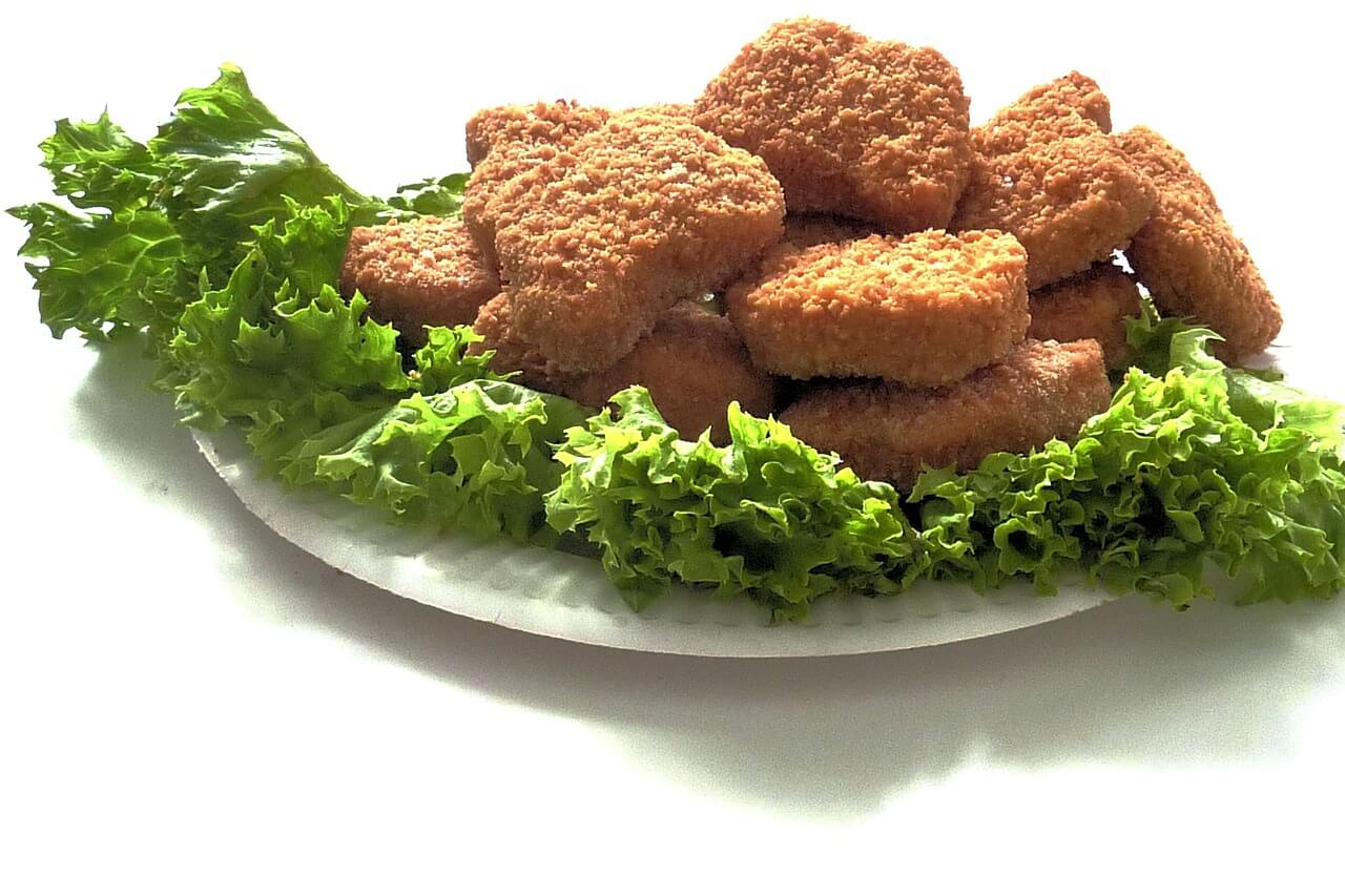 Can Dogs Eat Chicken Nuggets? Can It Make Them Sick?